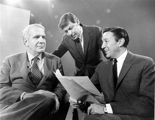 "This 1968 photo released by CBS shows ""60 Minutes"" correspondents Harry Reasoner, left, and Mike Wallace, right, with creator and producer Don Hewitt on the set in New York. Wallace, famed for his tough interviews on ""60 Minutes,"" has died, Saturday, April 7, 2012. He was 93. (AP Photo/CBS Photo Archive)"