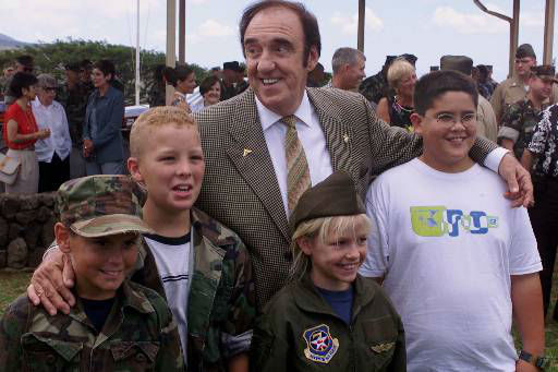 Actor Jim Nabors poses for a photo with young fans Thursday, Aug. 9, 2001, at Camp Smith in Hawaii after his television character Gomer Pyle was symbolically promoted to lance corporal after 37 years as a private first class. &#40;AP Photo&#47;Ronen Zilberman&#41; <span class=meta>(AP Photo&#47; RONEN ZILBERMAN)</span>