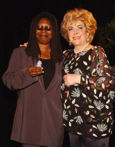 Actresses Whoopi Goldberg, recipient of an Angel Award, left, and Elizabeth Taylor pose for photographers at the Annual Angel Awards on Saturday, Aug. 18, 2001, in the West Hollywood section of Los Angeles.  &#40;AP Photo&#47;Chris Weeks&#41; <span class=meta>(AP Photo&#47; CHRIS WEEKS)</span>