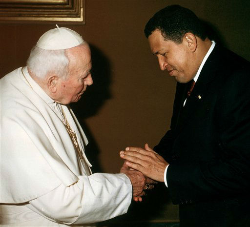 FILE - In this Oct. 12, 2001 file photo released by the Vatican, Pope John Paul II shakes hands with Venezuela&#39;s President Hugo Chavez during a private audience at the Vatican City Friday. Venezuela&#39;s Vice President Nicolas Maduro announced on Tuesday, March 5, 2013 that Chavez has died.  Chavez, 58, was first diagnosed with cancer in June 2011. &#40;AP Photo&#47;Arturo Mari, Vatican, File&#41; <span class=meta>(AP Photo&#47; Arturo Mari)</span>