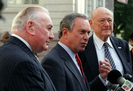 Former New York Gov. Hugh Carey, left, and former New York City Mayor Ed Koch, right, cross party lines to endorse Republican mayoral candidate Michael Bloomberg Thursday, Nov. 1, 2001, outside New York&#39;s City Hall.  &#40;AP Photo&#47;Marty Lederhandler&#41; <span class=meta>(AP Photo&#47; MARTY LEDERHANDLER)</span>