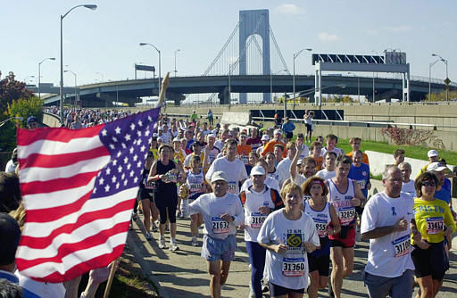 Runners of the New York City Marathon arrive in the Brooklyn borough of New York after crossing the Verrazano Bridge Sunday, Nov. 4, 2001. &#40;AP Photo&#47;Mark Lennihan&#41; <span class=meta>(AP Photo&#47; MARK LENNIHAN)</span>