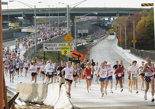 Runners pass the 2nd mile marker as they exit the Verrazano-Narrows Bridge into the New York borough of Brooklyn during the 32nd running of the New York City Marathon Sunday, Nov. 4, 2001, in New York. &#40;AP Photo&#47;William Lopez&#41; <span class=meta>(AP Photo&#47; WILLIAM LOPEZ)</span>