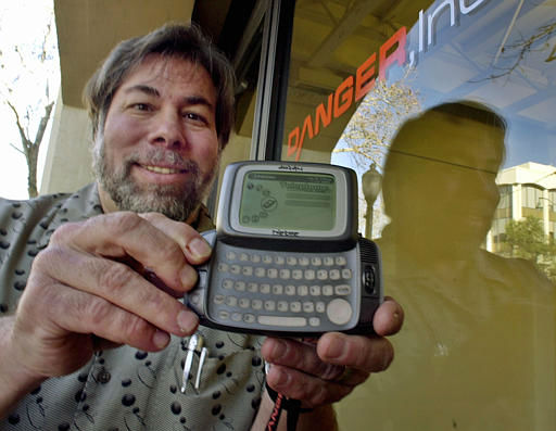 ADVANCE FOR SATURDAY FEB. 2-- Steve Wozniak, member of the board of directors of Danger Inc., holds up thei company&#39;s multi-function handheld device at Danger&#39;s offices in Palo Alto, Calif., Friday, Jan. 18, 2002.  The device combines a cell phone, Web.browsing, instant messaging and e-mail in one mobile unit. &#40;AP Photo&#47;Paul Sakuma&#41; <span class=meta>(AP Photo&#47; PAUL SAKUMA)</span>