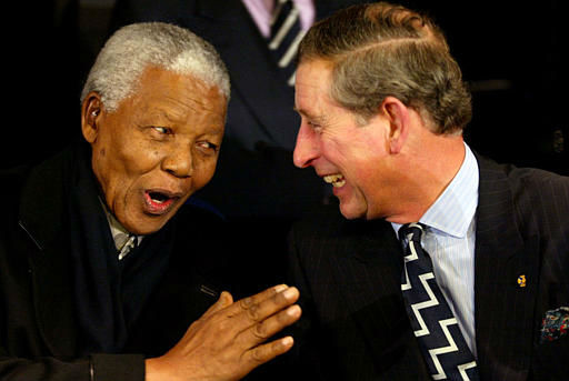 Nelson Mandela, left, and Britain&#39;s Prince Charles share a word during a royal wedding event at  an Amsterdam stadium  Friday, feb. 1, 2002. The festivity was held ahead of the wedding of Dutch Crown Prince Willem-Alexander and his Argentine fiancee Maxima Zorreguieta which will take place on Saturday Feb. 2, 2002.   &#40;AP Photo&#47;Robin Utrecht, Pool&#41; <span class=meta>(AP Photo&#47; ROBIN UTRECHT)</span>
