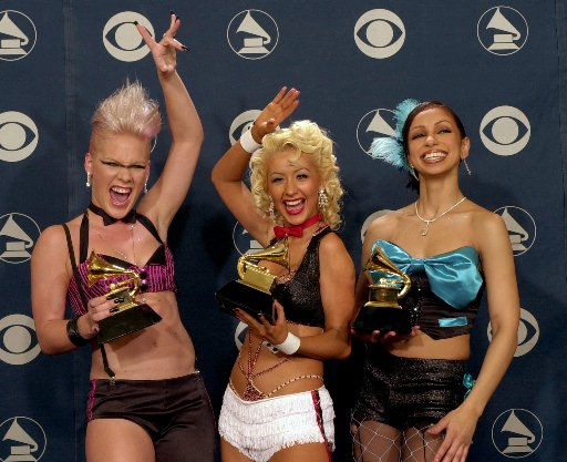 """<div class=""""meta image-caption""""><div class=""""origin-logo origin-image """"><span></span></div><span class=""""caption-text"""">From left: Pink, Christina Aguilera and Mya hold their awards after winning for best pop collaboration with vocals for the song """"Lady Maramalade"""" from the movie """"Moulin Rouge"""" at the 44th annual Grammy Awards, Wednesday, Feb. 27, 2002, in Los Angeles. (AP Photo/Reed Saxon) (AP Photo/ REED SAXON)</span></div>"""