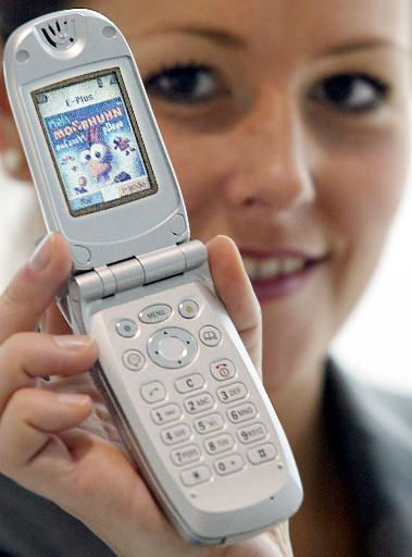 An unidentified model sports the i-mode handset of German telephone provider E-plus, designed by NEC, in Duesseldorf, western Germany, Monday March 4, 2002. E-plus will start the i-mode service on March 8, 2002. The service allows the clients to use games, as seen on the cell phone&#39;s screen, and other internet services. &#40;AP Photo&#47;Frank Augstein&#41; <span class=meta>(AP Photo&#47; FRANK AUGSTEIN)</span>