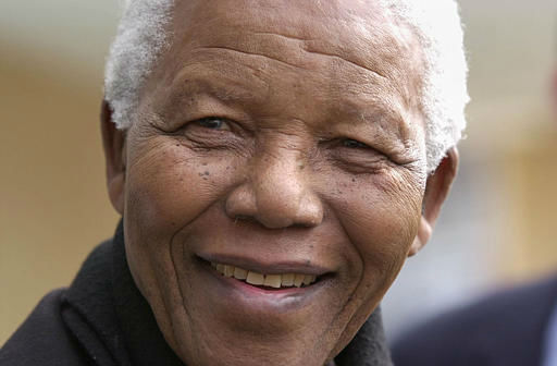 Former South African President Nelson Mandela smiles as he arrives at the Oxford University, Said Business School in Oxford, England Saturday, April 13, 2002. Oxford University named their newest 300 seat lecture theatre in the Said Business School after Nelson Mandela, who gave a lecture at the school Saturday. &#40;AP Photo&#47;Richard Lewis&#41; <span class=meta>(AP Photo&#47; RICHARD LEWIS)</span>