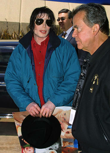 "<div class=""meta image-caption""><div class=""origin-logo origin-image ""><span></span></div><span class=""caption-text"">Performer Michael Jackson, left, talks with Dick Clark, host of the American Bandstand 50th...A Celebration as Jackson arrives for the taping of the show Saturday, April 20, 2002 in Pasadena, Calif. The show will air May 3. (AP Photo/str) (AP Photo/ STR)</span></div>"