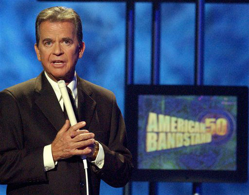 FILE - In this April 20, 2002 file photo, Dick Clark, host of the American Bandstand television show, introduces entertainer Michael Jackson on stage during taping of the show&#39;s 50th anniversary special in Pasadena, Calif. Clark, the television host who helped bring rock `n&#39; roll into the mainstream on &#34;American Bandstand,&#34; died Wednesday, April 18, 2012 of a heart attack. He was 82. &#40;AP Photo&#47;Kevork Djansezian, File&#41; <span class=meta>(AP Photo&#47; KEVORK DJANSEZIAN)</span>