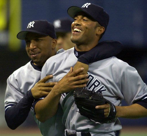 New York Yankees&#39; Enrique Wilson, left, hugs relief pitcher Mariano Rivera as the Yankees leave the field after beating the Minnesota Twins 4-2 in Minneapolis, Saturday, May 11, 2002. Rivera got the save. &#40;AP Photo&#47;Eric Miller&#41; <span class=meta>(AP Photo&#47; ERIC MILLER)</span>