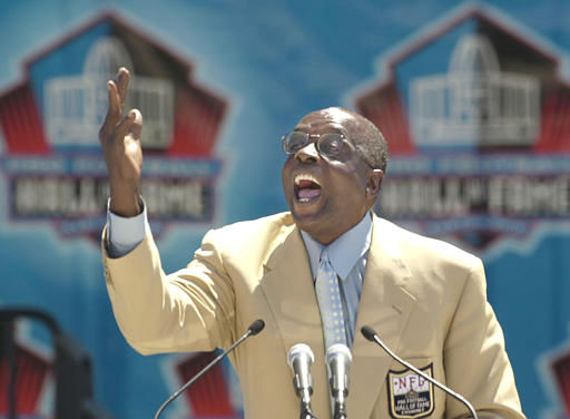 Hall of Fame defensive end Deacon Jones presents the late coach George Allen for enshrinement into the Pro Football Hall of Fame in Canton, Ohio Saturday, Aug. 3, 2002. Allen&#39;s son, Sen. George Allen &#40;R-Va.&#41; accepted for his father. &#40;AP Photo&#47;Mark Duncan&#41; <span class=meta>(AP Photo&#47; MARK DUNCAN)</span>