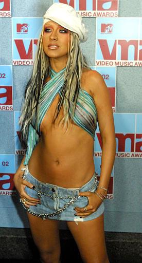 "<div class=""meta image-caption""><div class=""origin-logo origin-image ""><span></span></div><span class=""caption-text"">Christina Aguilera arrives at Radio City Music Hall for the MTV Video Music Awards in New York, Thursday, Aug. 29, 2002.  (AP Photo/Tina Fineberg) (AP Photo/ TINA FINEBERG)</span></div>"