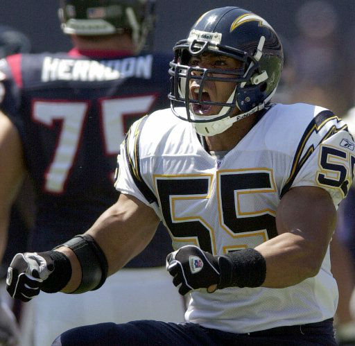 San Diego Chargers&#39; Junior Seau does a celebration dance after one of his seven tackles in the Chargers&#39; 24-3 win over the Houston Texans, Sunday, Sept. 15, 2002, in San Diego. Seau also had a sack and an interception to set up a Chargers touchdown. &#40;AP Photo&#47;Lenny Ignelzi&#41; <span class=meta>(AP Photo&#47; LENNY IGNELZI)</span>