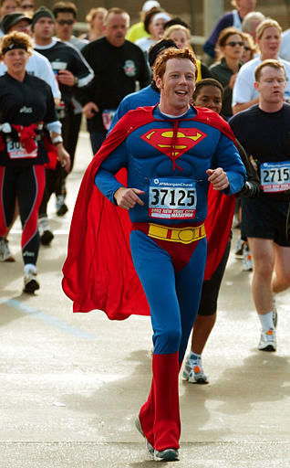 Paul Shanley of Freshfield, Great Britain, wears a Superman costume as he makes his way across the marathon halfway point, the Pulaski Bridge in Queens, Sunday, Nov. 3, 2002, in New York, during the annual New York City marathon. Some 30,000 runners from all over the world competed in the 26.2 mile race. &#40;AP Photo&#47;Kathy Willens&#41; <span class=meta>(AP Photo&#47; KATHY WILLENS)</span>