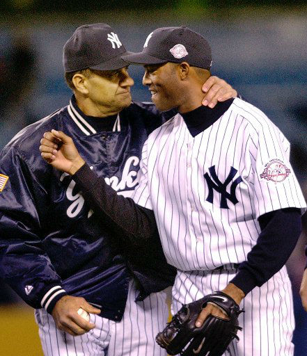 New York Yankees manager Joe Torre, left, puts his arms around closer Mariano Rivera as the team leaves the field following the Yankees 8-5 victory over the Seattle Mariners, Wednesday, April 30, 2003, at Yankee Stadium in New York. It was Rivera&#39;s first regular season appearance after returning from a groin injury he suffered during spring training. &#40;AP Photo&#47;Kathy Willens&#41; <span class=meta>(AP Photo&#47; KATHY WILLENS)</span>
