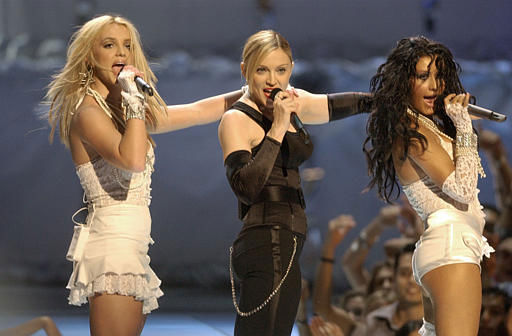 """<div class=""""meta image-caption""""><div class=""""origin-logo origin-image """"><span></span></div><span class=""""caption-text"""">Britney Spears, left, Madonna, center, and Christina Aguilera perform during the MTV Video Music Awards at New York's Radio City Music Hall Thursday, Aug. 28, 2003. (AP Photo/Julie Jacobson) (AP Photo/ JULIE JACOBSON)</span></div>"""