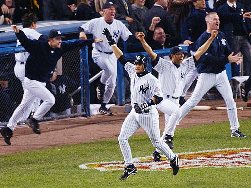 New York Yankees&#39; Aaron Boone, center, celebrates after hitting a solo home run in the eleventh inning to beat the Boston Red Sox in Game 7 of the American League Championship Series Thursday, Oct. 16, 2003 in New York. The Yankees won 6-5. Behind him are pitcher Mike Mussina, pitching coach Mel Stottlemyre, pitcher Mariano Rivera, and pitcher Jeff Nelson. &#40;AP Photo&#47;Bill Kostroun&#41; <span class=meta>(AP Photo&#47; BILL KOSTROUN)</span>