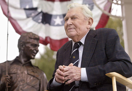 Andy Griffith sits in front of a bronze statue of Andy and Opie from the &#34;Andy Griffith Show,&#34; Tuesday, Oct. 28, 2003, after the statue was unveiled during a ceremony in Raleigh, N.C.  Griffith&#39;s 40-year acting career has been largely defined by Sheriff Andy Tayor, who he played in the show. &#40;AP Photo&#47;Bob Jordan&#41; <span class=meta>(AP Photo&#47; BOB JORDAN)</span>