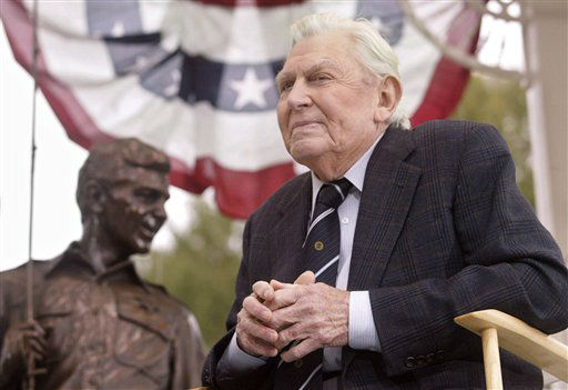 "<div class=""meta ""><span class=""caption-text "">**FILE** Andy Griffith sits in front of a bronze statue of Andy and Opie from the ""Andy Griffith Show,"" in this Tuesday, Oct. 28, 2003 file photo, after the statue was unveiled during a ceremony in Raleigh, N.C.  Griffith, the actor who portrayed the sheriff of the fictional town of Mayberry, N.C., has sued a Wisconsin resident who unsuccessfully bid for the Grant County post after legally changing his name to Andrew Jackson Griffith in May.  (AP Photo/Bob Jordan, File) (AP Photo/ BOB JORDAN)</span></div>"
