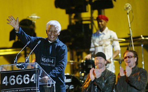 Former South African President Nelson Mandela, left, at the Nelson Mandela AIDS Benefit Concert in Cape Town, South Africa, Saturday Nov. 29, 2003. The number 46664 is the prisoner number Mandela was issued during his years of imprisonment. At back is Bono, right, and The Edge, second from right, from the rock band U2. &#40;AP Photo&#47;str&#41; <span class=meta>(AP Photo&#47; Anonymous)</span>