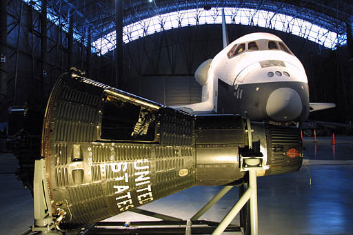 The Space Shuttle Enterprise test craft, rear, or the Mercury 15-B Orbiter, designed for astronaut Alan Shepard, are seen in the National Air and Space Museum&#39;s new Udvar-Hazy Center Friday, Dec. 5, 2003 in Chantilly, Va. The center will open Dec. 15, 2003 as a celebration of the 100th anniversary of the first powered flights by the Wright brothers who acturally flew on Dec. 17, 1903. &#40;AP Photo&#47;Adele Starr&#41; <span class=meta>(AP Photo&#47; ADELE STARR)</span>