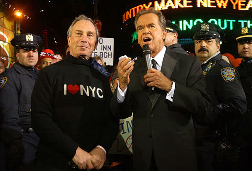 Dick Clark, right, interviews New York City Mayor Michael Bloomberg surrounded by New York City Police officers during New Year&#39;s celebrations late Wednesday night, Dec. 31, 2003, in times Square New York that took place under some of the tightest anti-terrorism measures in U.S. history. With the nation on high alert for possible terror attacks  more police officers were on duty this year than last and police said after midnight that there were no reports of crowd trouble . &#40;AP Photo&#47;Ramin Talaie&#41; <span class=meta>(AP Photo&#47; RAMIN TALAIE)</span>