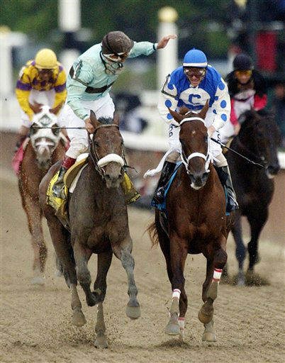 FILE - In this June 5, 2004, file photo, jockey Edgar S. Prado, left, aboard Birdstone, reacts after winning the Belmont Stakes horse race as jockey Stewart Elliott, right, aboard Smarty Jones, watches at Belmont Park in Elmont, N.Y. Early duels with Rock Hard Ten and Eddington along the backstretch proved to be Smarty&#39;s undoing, as the horse would go on to tire in the stretch and be caught in the final 70 yards by 36-1 long shot Birdstone. As I&#39;ll Have Another prepares to attempt to win the Belmont Stakes in his quest to become the 12th Triple Crown champion and first in 34 years on Saturday, June 9, 2012, The Associated Press takes a look at some of the 19 horses who won the Kentucky Derby and the Preakness, but came up short in the final leg of the Triple Crown, and how the race unfolded. &#40;AP Photo&#47;Frank Franklin II, File&#41; <span class=meta>(AP Photo&#47; Frank Franklin II)</span>