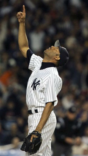 New York Yankees pitcher Mariano Rivera points to a pop up in the ninth inning against the Boston Red Sox during game one of the ALCS in New York Tuesday, Oct. 12, 2004. The Yankees prevailed 10-7. &#40;AP Photo&#47;Charles Krupa&#41; <span class=meta>(AP Photo&#47; CHARLES KRUPA)</span>