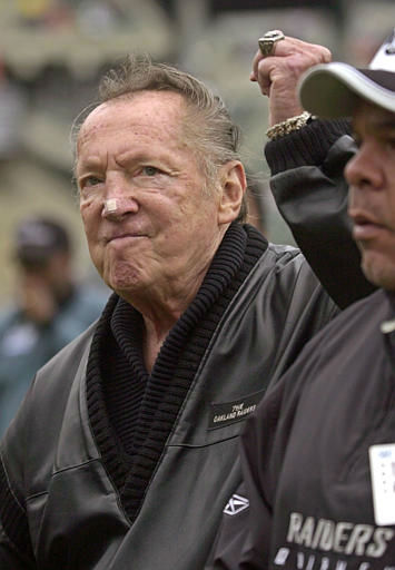 Oakland Raiders owner Al Davis gestures to fans before the Raiders game against the Denver Broncos Sunday, Oct. 17, 2004, in Oakland, Calif. Raiders wide receiver Jerry Rice told the team he wants to be traded if he can&#39;t have a significant role, and he met with owner Davis on Wednesday night to discuss it.  &#40;AP Photo&#47;Paul Sakuma&#41; <span class=meta>(AP Photo&#47; PAUL SAKUMA)</span>