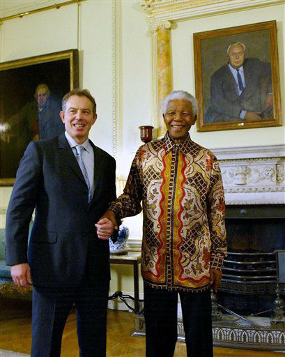 South Africa&#39;s former President Nelson Mandela, right, meets with British Prime Minister Tony Blair, left, at 10 Downing Street, in London on Friday,  Nov. 26, 2004. At right is a painting of former British Prime Minister Harold Wilson. &#40;AP Photo &#47; Nicolas Asfouri &#47; WPA Pool&#41; <span class=meta>(AP Photo&#47; NICOLAS ASFOURI)</span>