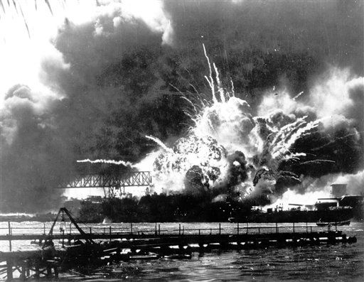 The USS Shaw explodes after being hit by bombs during the Japanese surprise attack on Pearl Harbor, Hawaii, in this Dec. 7, 1941 photo. &#40;AP Photo, U.S. Navy, File&#41; <span class=meta>(AP Photo&#47; CD XCB CD JC CD)</span>