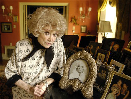 Phyllis Diller poses with her photos at her home in the Brentwood section of Los Angeles in 2005. Diller died on Monday, August 20, 2012 at the age of 95. &#40;AP Photo&#47;Chris Pizzello&#41; <span class=meta>(AP Photo&#47; CHRIS PIZZELLO)</span>