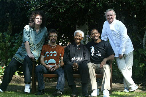 South Africa&#39;s former President Nelson Mandela, centre poses for photographs with  stars from the world of entertainment, from left,  Brian May, Paul Rodgers, Will Smith and Roger Taylor, at a photo call in George, South Africa, Friday, March, 18, 2005.  The performers are in the coastal town to perform in Mandela&#39;s 46664, AIDS benefit concert to be held on Saturday.&#40;AP Photo &#47; Obed Zilwa&#41; <span class=meta>(AP Photo&#47; OBED ZILWA)</span>