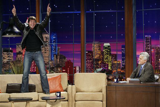 In this photo released by NBC, Tom Cruise jumps onto the sofa after greeting host Jay Leno on the set of &#34;The Tonight Show with Jay Leno,&#34; during the taping of the show at NBC studios in Burbank, Calif., on Wednesday, June 8, 2005. When asked about his relationship with Katie Holmes, Cruise said he &#34;is looking forward to traveling, scuba diving and spending the rest of his life with her.&#34; &#40;AP Photo&#47;Paul Drinkwater, NBC&#41; <span class=meta>(AP Photo&#47; PAUL DRINKWATER)</span>