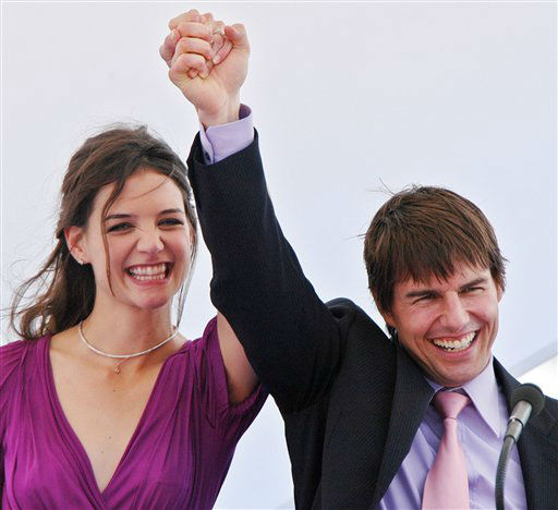 American actor Tom Cruise, right, waves to wellwishers as he arrives with his fiancee actress Katie Holmes in the old port of Marseille, southern France, Friday, June 17, 2005. Cruise who is in France to promote the Steven Spielberg film &#34;The War of the Worlds&#34;,  proposed to Holmes earlier on at the Eiffel Tower in Paris. &#40;AP Photo&#47;Claude Paris&#41; <span class=meta>(AP Photo&#47; CLAUDE PARIS)</span>
