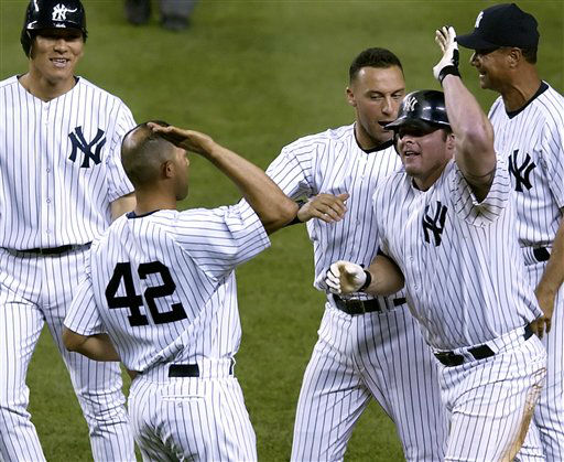 "<div class=""meta ""><span class=""caption-text "">New York Yankees' Jason Giambi, right, celebrates with closer Mariano Rivera (42) after he singled with the bases loaded to beat the New York Mets, 5-4, Sunday night, June 26, 2005 at Yankee Stadium in New York. Yankees' Hideki Matsui, left, and Derek Jeter, rear, join in. (AP Photo/Bill Kostroun) (AP Photo/ BILL KOSTROUN)</span></div>"