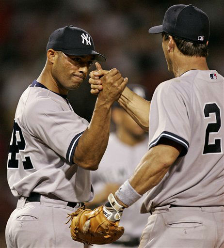 New York Yankees pitcher Mariano Rivera is congratulated by teammate Tino Martinez after the Yankees defeated the Boston Red Sox 5-3 at Fenway Park in Boston Sunday, July 17, 2005. &#40;AP Photo&#47;Winslow Townson&#41; <span class=meta>(AP Photo&#47; WINSLOW TOWNSON)</span>