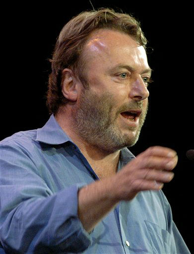 "<div class=""meta image-caption""><div class=""origin-logo origin-image ""><span></span></div><span class=""caption-text"">Essayist Christopher Hitchens speaks during a debate on Iraq and the foreign policies of the United States and Britain, in this Sept. 14, 2005 file photo taken in New York. Vanity Fair reports Hitchens died on Thursday Dec. 15, 2011 at the age of 62 from complications of cancer of the esophagus his magazine. The magazine reports he died in the presence of friends at the MD Anderson Cancer Center in Houston, Texas. (AP Photo/Chad Rachman) (AP Photo/ CHAD RACHMAN)</span></div>"