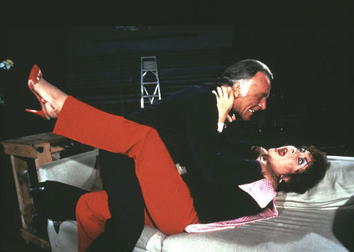 British actor Richard Burton appears to strangle Elizabeth Taylor during a scene from the Broadway revival of Noel Coward&#39;s &#34;Private Lives&#34;. The comedy is scheduled to open on May. 8, 1983, at the Lunt-Fontanne Theatre in New York. &#40;AP Photo&#47;Swope&#47;HO&#41; <span class=meta>(AP Photo&#47; MARTHA SWOPE)</span>