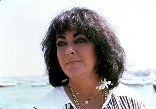 "<div class=""meta image-caption""><div class=""origin-logo origin-image ""><span></span></div><span class=""caption-text"">British actress Elizabeth Taylor is seen here in 1979. Exact date and location unknown. (AP Photo) (AP Photo/ XKR)</span></div>"