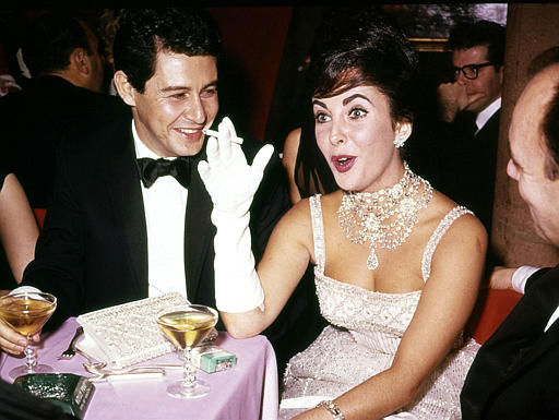 "<div class=""meta ""><span class=""caption-text "">British actress Elizabeth Taylor jokes with husband Eddie Fisher during a party at Leone's restaurant in New York City, Nov. 1959. Exact date unknown. (AP Photo) (AP Photo/ XKR)</span></div>"