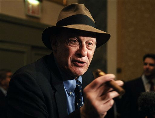 "<div class=""meta ""><span class=""caption-text "">In this file photo taken Oct. 28, 2005, boxing historian Bert Sugar is seen at the Friars Club Roast in New York. Sugar, known for his fedora and cigar, has died. Jennifer Frawley, Sugar's daughter, said cardiac arrest caused his death on Sunday, March 25, 2012. His wife, Suzanne, was by his side when he passed away. (AP Photo/Louis Lanzano, file) (AP Photo/ Louis Lanzano)</span></div>"