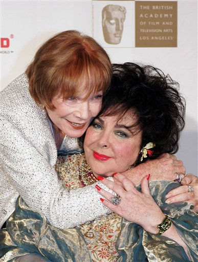 Actress Shirley MacLaine, left, hugs Dame Elizabeth Taylor at the British Film and Television Academy&#47;Los Angeles Cunard Britannia Awards, Thursday night, Nov. 10, 2005, in Beverly Hills, Calif. Taylor received the Britannia Award for Artistic Excellence in International Entertainment. &#40;AP Photo&#47;Mark J. Terrill&#41; <span class=meta>(AP Photo&#47; MARK J. TERRILL)</span>