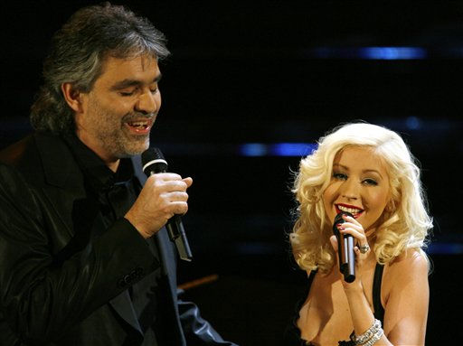 """<div class=""""meta image-caption""""><div class=""""origin-logo origin-image """"><span></span></div><span class=""""caption-text"""">Andrea Bocelli and Christina Aguilera perform during the """"Festival di Sanremo"""" Italian songs contest, in San Remo, Italy, Saturday, March 4, 2006.  Bocelli and Aguilera are two of the international guest stars featuring in the show aired on Italian State TV RAI. (AP Photo/Luca Bruno) (AP Photo/ LUCA BRUNO)</span></div>"""