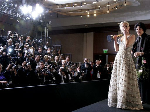 Reese Witherspoon reacts as the film &#34;Crash,&#34; which her husband Ryan Phillippe stars in, won the Oscar for best picture while she was posing with the Oscar she won for best actress for her work in &#34;Walk the Line&#34; at the 78th Academy Awards Sunday, March 5, 2006, in Los Angeles. &#40;AP Photo&#47;Kevork Djansezian&#41; <span class=meta>(AP Photo&#47; KEVORK DJANSEZIAN)</span>