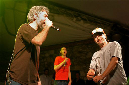 "<div class=""meta ""><span class=""caption-text "">The Beastie Boys' Adam Yauch, (MCA), left, takes his turn at the mike with Adam Horovitz, (Ad-rock), right, and Mike Diamond, (Mike D), move to the beat during a SXSW Music Festival ""suprise"" concert at Stubb's Barbecue in Austin, Texas, Thursday, March 16, 2006. (AP Photo/Jack Plunkett) (AP Photo/ JACK PLUNKETT)</span></div>"