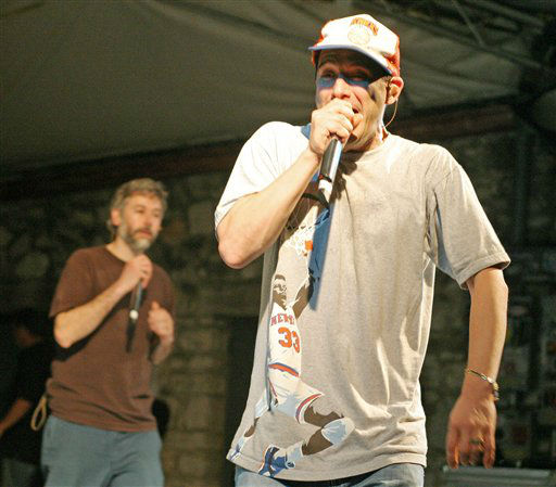 The Beastie Boys&#39; Adam Horovitz, &#40;Ad-rockright&#41;, takes his turn at the mike with Adam Yauch, &#40;MCA&#41;, following behind during a SXSW Music Festival &#34;suprise&#34; concert at Stubb&#39;s Barbecue in Austin, Texas, Thursday, March 16, 2006.&#40;AP Photo&#47;Jack Plunkett&#41; <span class=meta>(AP Photo&#47; JACK PLUNKETT)</span>