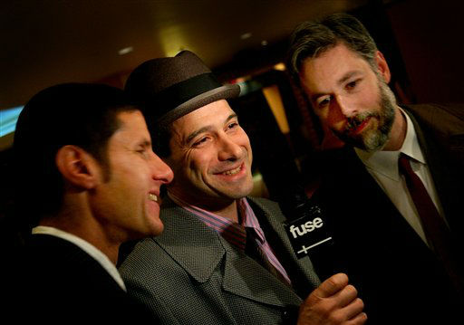 "<div class=""meta image-caption""><div class=""origin-logo origin-image ""><span></span></div><span class=""caption-text"">Left to right, Beastie Boys Mike D (Michael Diamond), Adrock (Adam Horovitz), and MCA (Adam Yauch) arrive at the premiere of their new film ""Awesome; I ... Shot That!"" Tuesday, March 28, 2006 in New York.  The film, which documents a 2004 Beastie Boys concert at New York's Madison Square Garden, is comprised of footage shot by 50 fans who were given cameras to record the show.  The film will be released in selected cities Friday, March 31, 2006.  (AP Photo/Jason DeCrow) (AP Photo/ JASON DECROW)</span></div>"