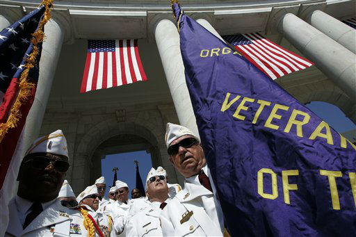 The Veterans of Foreign Wars honor guard gets ready to troop the colors during a ceremony marking Memorial Day at Arlington National Ceremony in Arlington, Va., Monday, May 29, 2006. President Bush also attended the event.  &#40;AP Photo&#47;Charles Dharapak&#41;  <span class=meta>(AP Photo&#47; CHARLES DHARAPAK)</span>